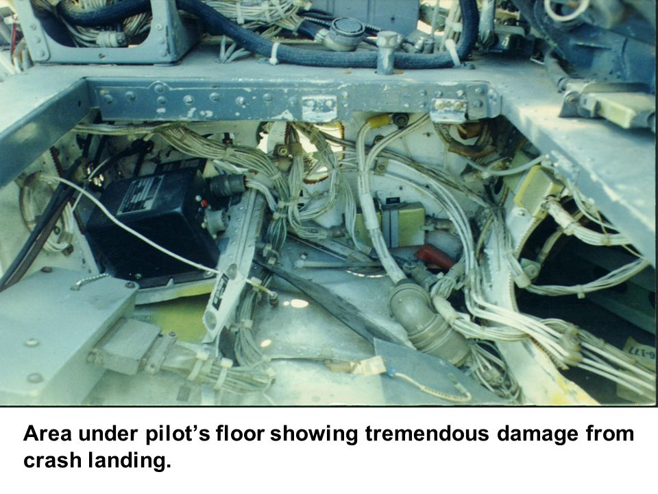 Area under pilot's floor showing tremendous damage from crash landing.