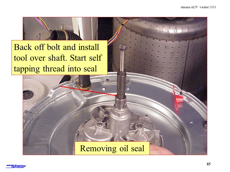 Using lip seal tool Removing oil seal. Back off bolt and install tool over shaft. Start self tapping thread into seal.