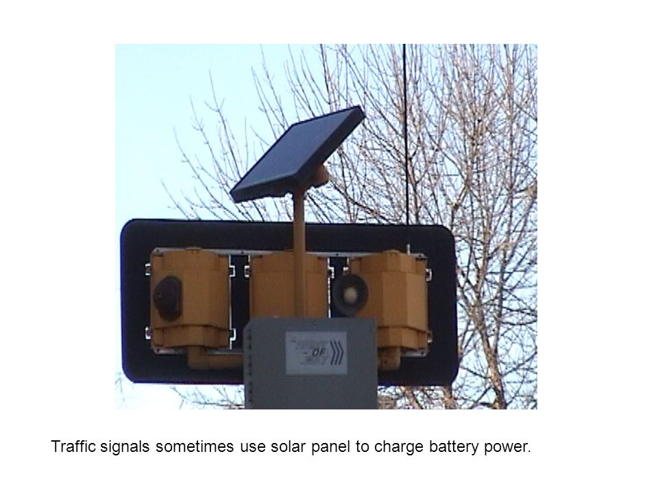 Traffic signals sometimes use solar panel to charge battery power.