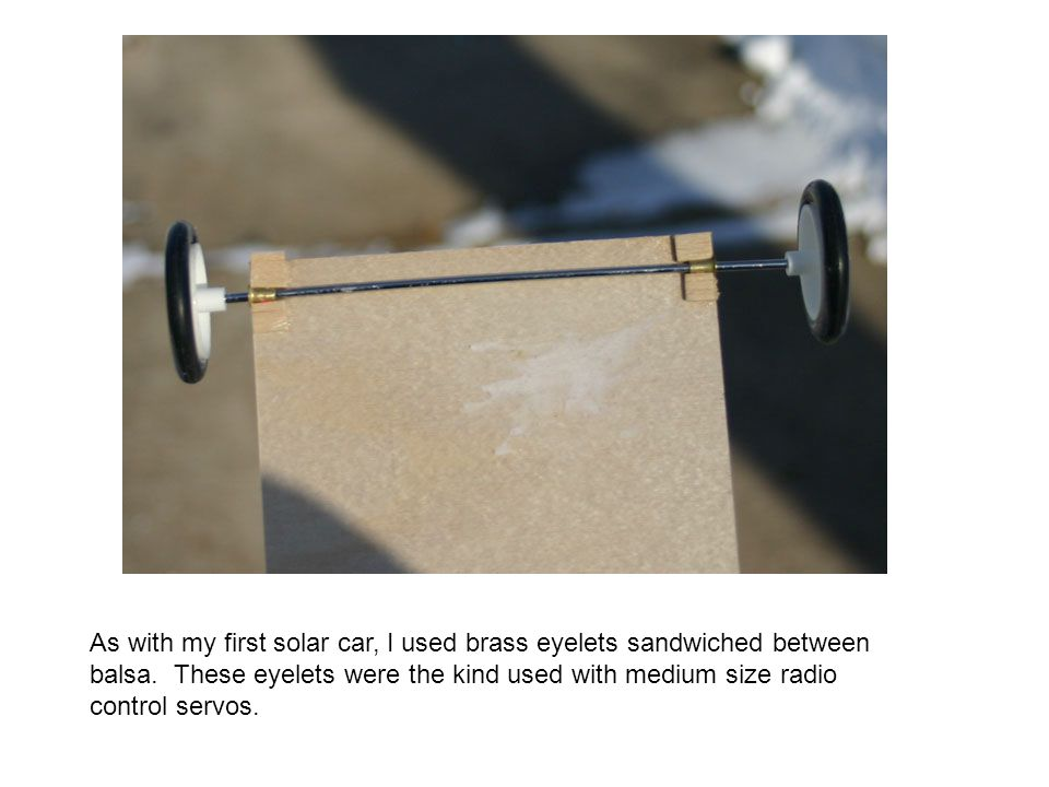 As with my first solar car, I used brass eyelets sandwiched between balsa.