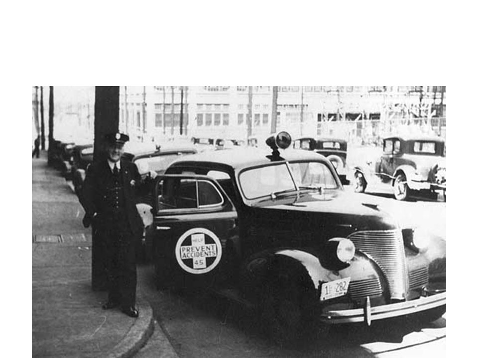 Nashville Patrolman George Silent Sam Griffin with Accident Car used by the department in the early forties to work traffic accidents.