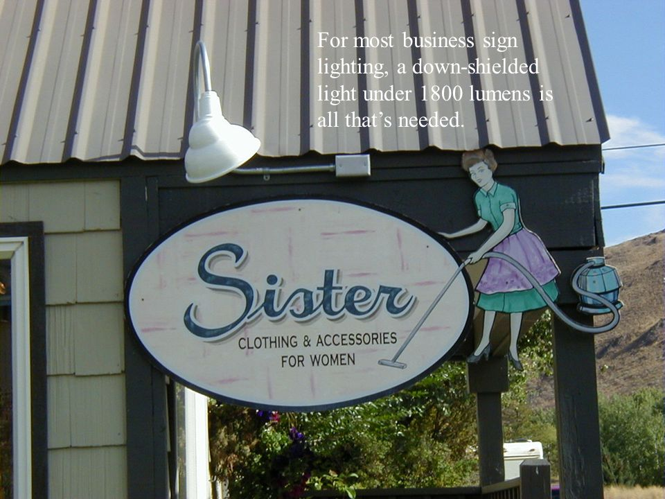 For most business sign lighting, a down-shielded light under 1800 lumens is all that's needed.