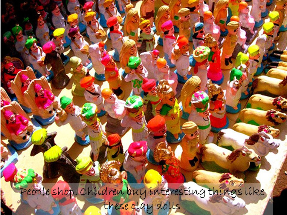 People shop. Children buy interesting things like these clay dolls
