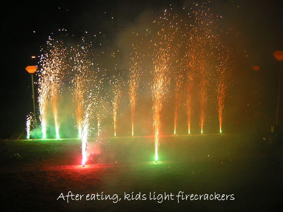 After eating, kids light firecrackers