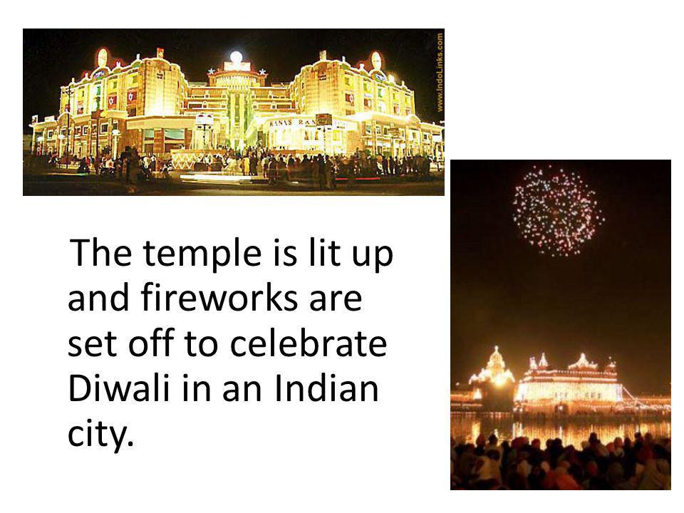 The temple is lit up and fireworks are set off to celebrate Diwali in an Indian city.
