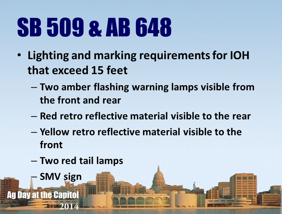 SB 509 & AB 648 Lighting and marking requirements for IOH that exceed 15 feet. Two amber flashing warning lamps visible from the front and rear.