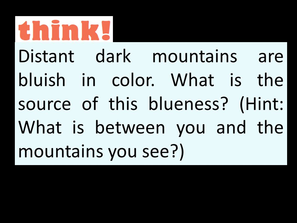 Distant dark mountains are bluish in color