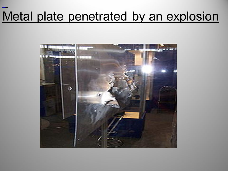 Metal plate penetrated by an explosion