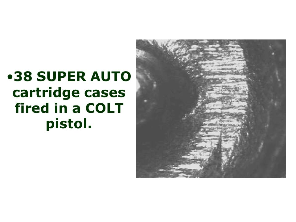 38 SUPER AUTO cartridge cases fired in a COLT pistol.