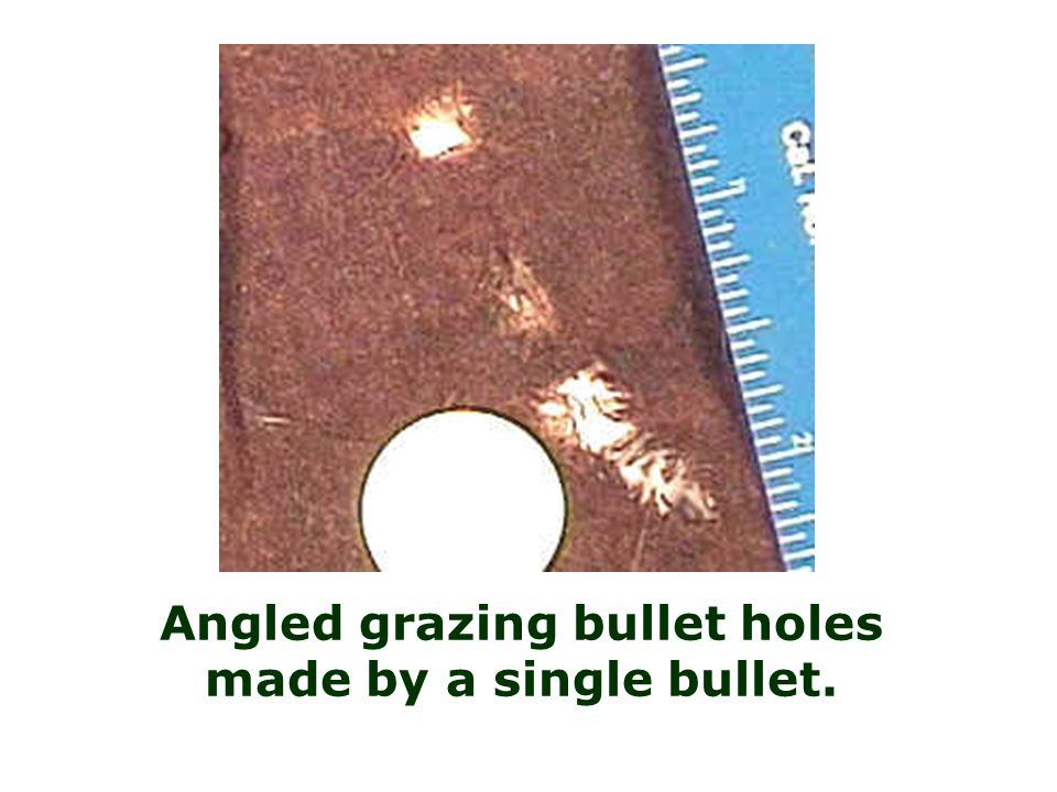 Angled grazing bullet holes made by a single bullet.