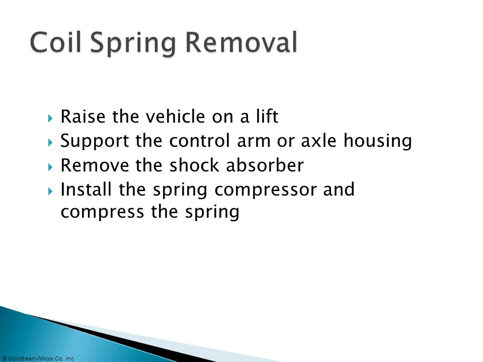 Coil Spring Removal Raise the vehicle on a lift