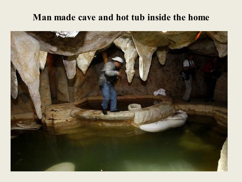 Man made cave and hot tub inside the home