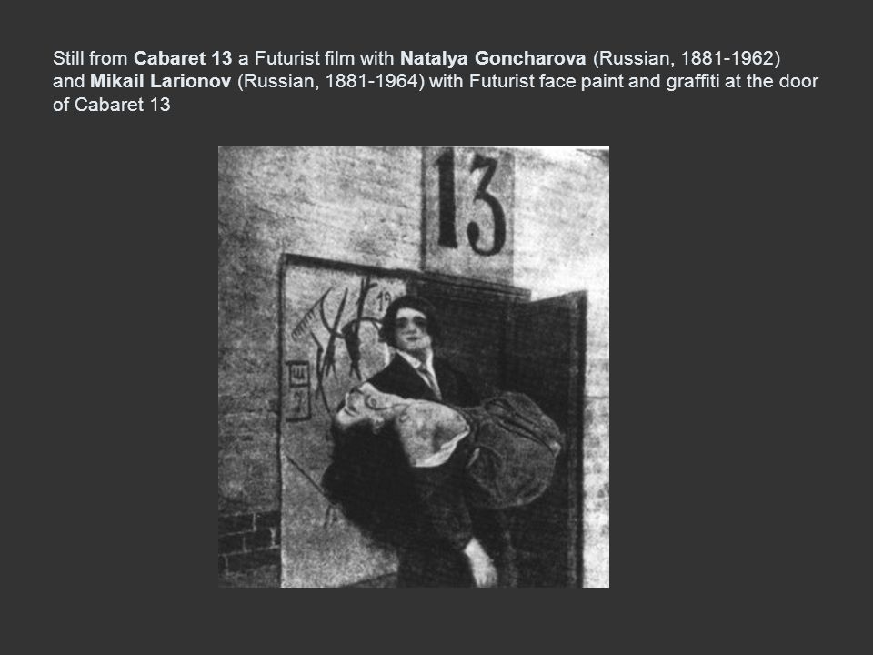 Still from Cabaret 13 a Futurist film with Natalya Goncharova (Russian, 1881-1962) and Mikail Larionov (Russian, 1881-1964) with Futurist face paint and graffiti at the door of Cabaret 13