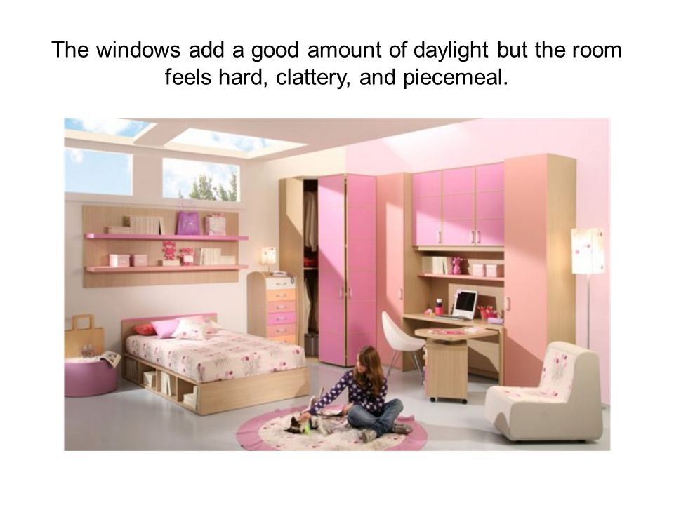 The windows add a good amount of daylight but the room feels hard, clattery, and piecemeal.