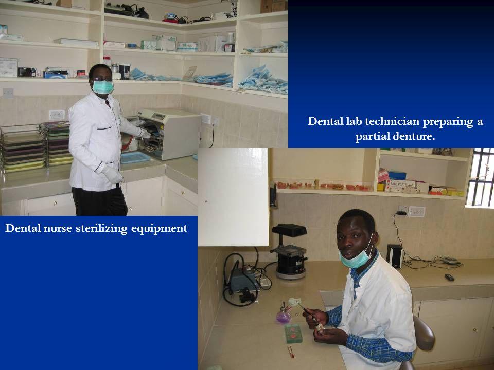 Dental lab technician preparing a partial denture.