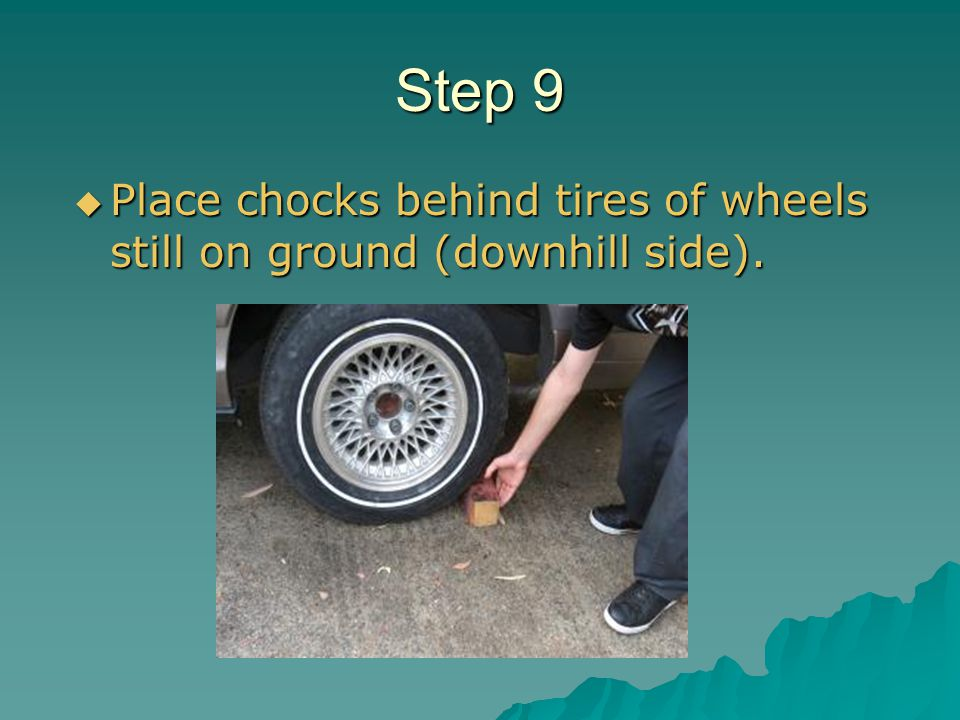 Step 9 Place chocks behind tires of wheels still on ground (downhill side).