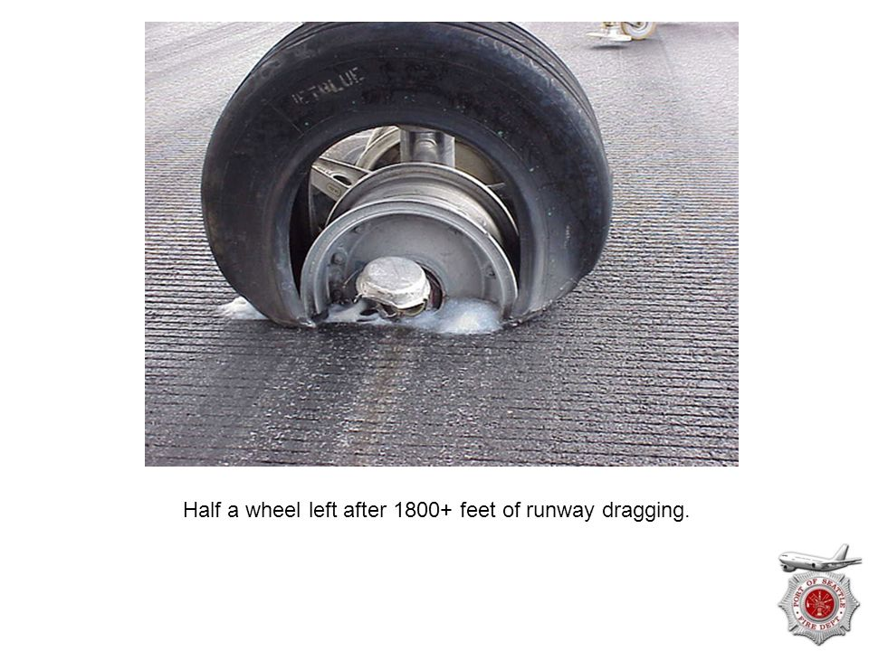 Half a wheel left after 1800+ feet of runway dragging.