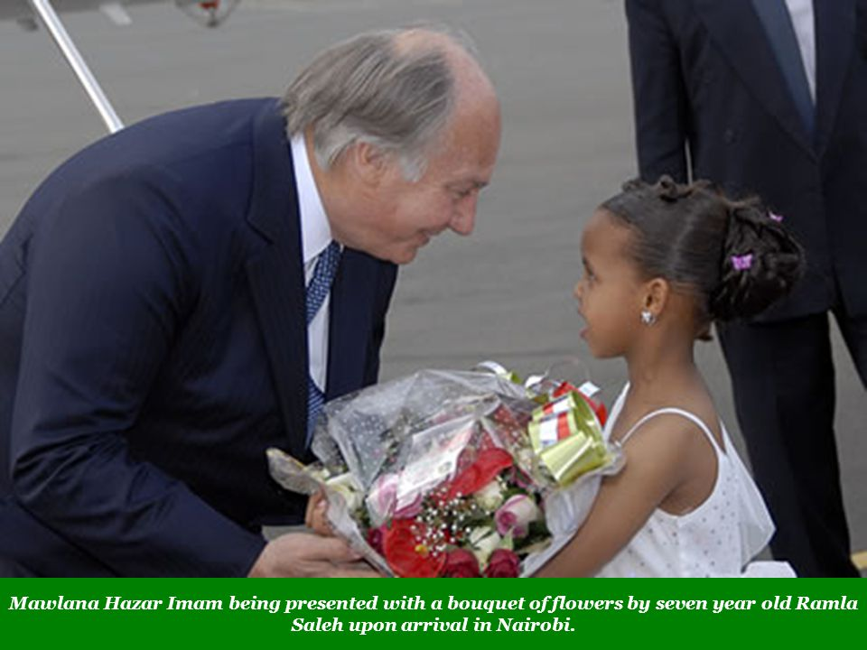 Mawlana Hazar Imam being presented with a bouquet of flowers by seven year old Ramla Saleh upon arrival in Nairobi.