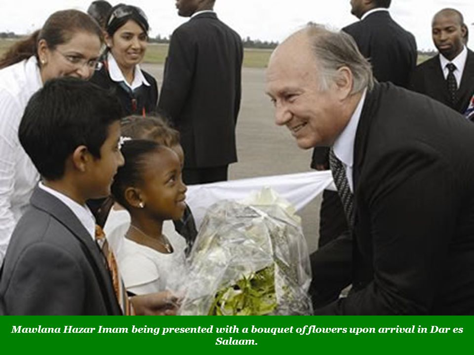 Mawlana Hazar Imam being presented with a bouquet of flowers upon arrival in Dar es Salaam.