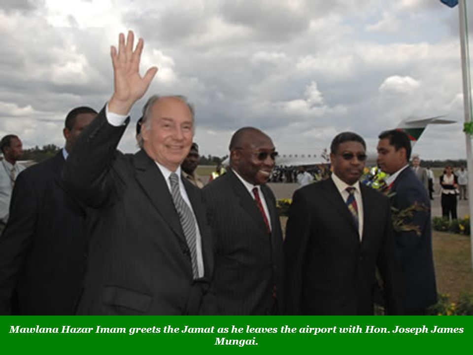 Mawlana Hazar Imam greets the Jamat as he leaves the airport with Hon