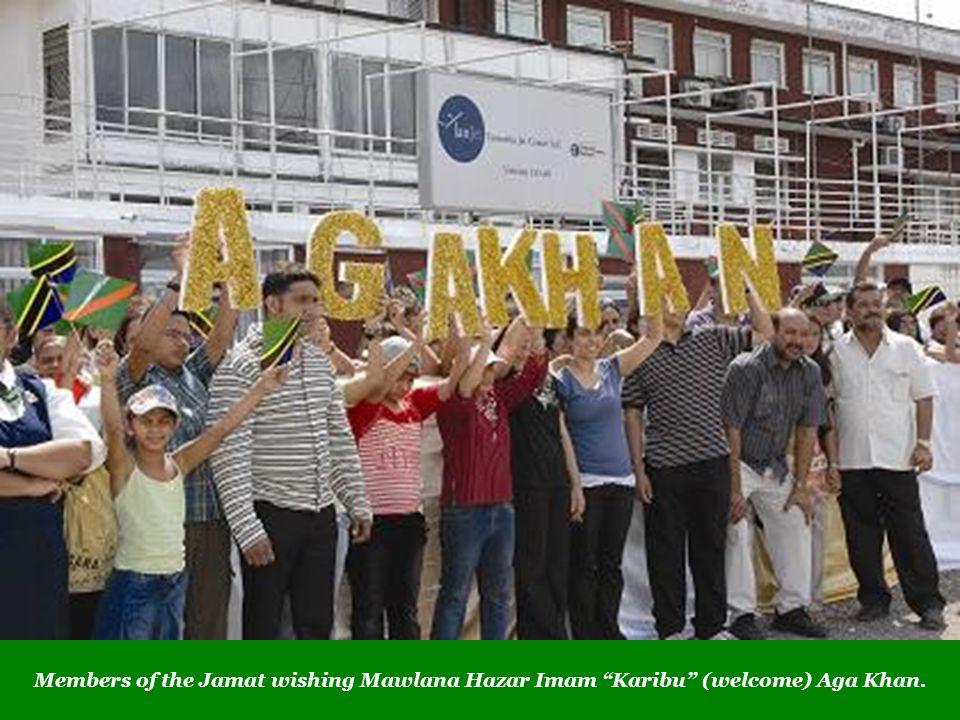 Members of the Jamat wishing Mawlana Hazar Imam Karibu (welcome) Aga Khan.