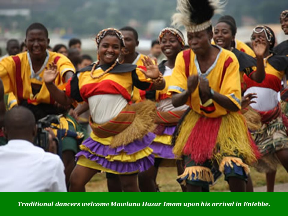 Traditional dancers welcome Mawlana Hazar Imam upon his arrival in Entebbe.