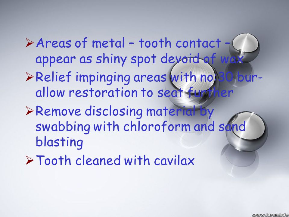 Areas of metal – tooth contact –appear as shiny spot devoid of wax