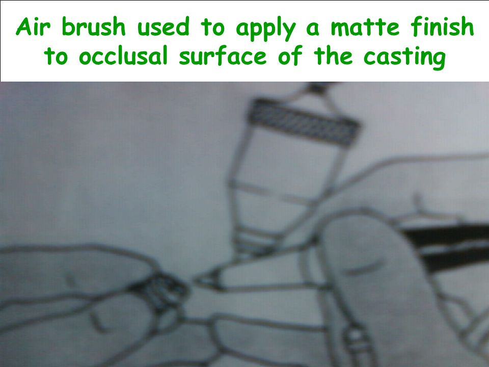 Air brush used to apply a matte finish to occlusal surface of the casting