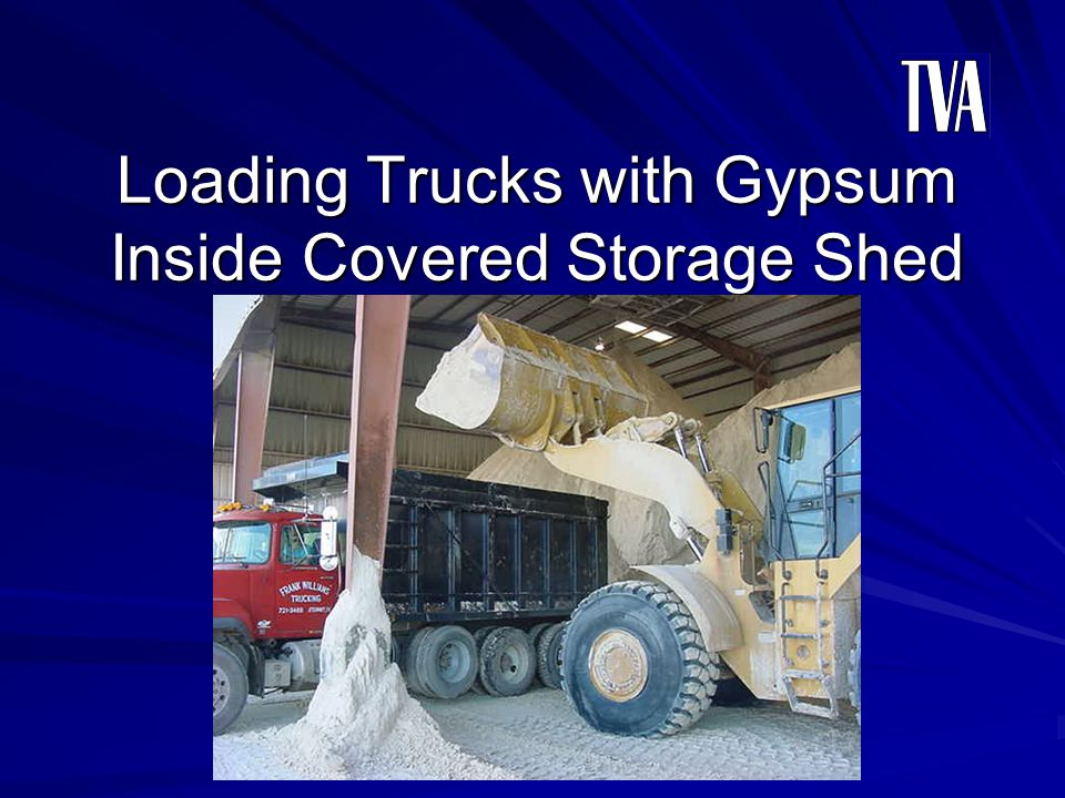 Loading Trucks with Gypsum Inside Covered Storage Shed