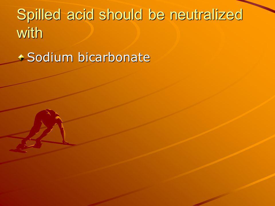Spilled acid should be neutralized with