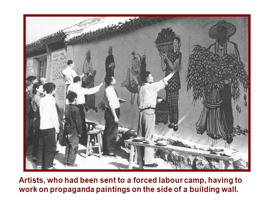 Artists, who had been sent to a forced labour camp, having to work on propaganda paintings on the side of a building wall.