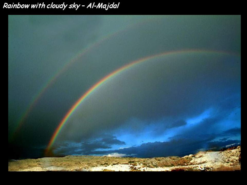 Rainbow with cloudy sky – Al-Majdal