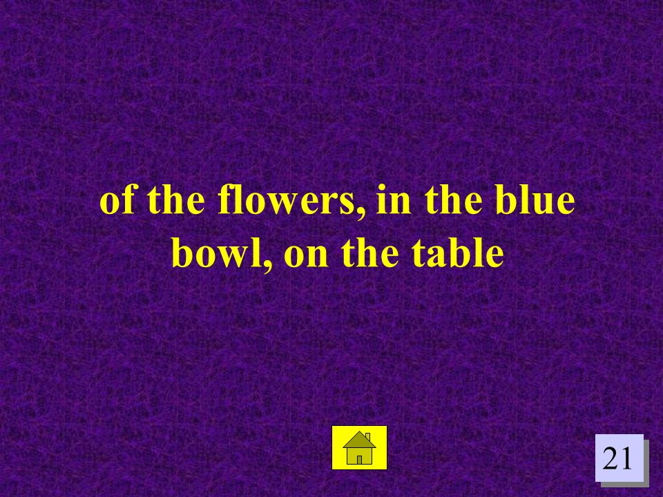 of the flowers, in the blue bowl, on the table