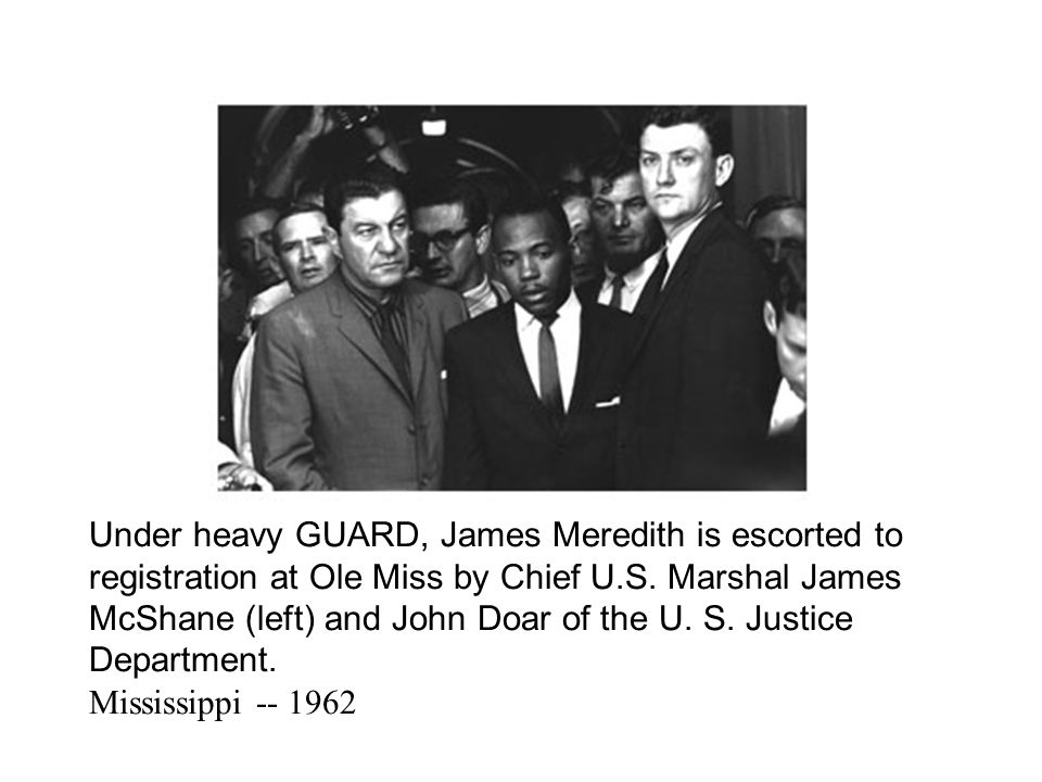 Under heavy GUARD, James Meredith is escorted to registration at Ole Miss by Chief U.S.