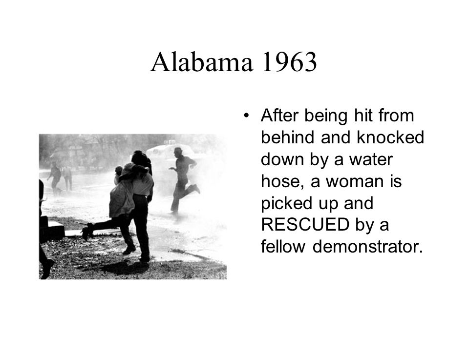 Alabama 1963 After being hit from behind and knocked down by a water hose, a woman is picked up and RESCUED by a fellow demonstrator.