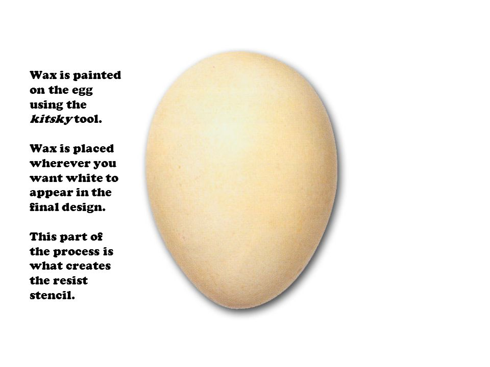 Wax is painted on the egg using the kitsky tool
