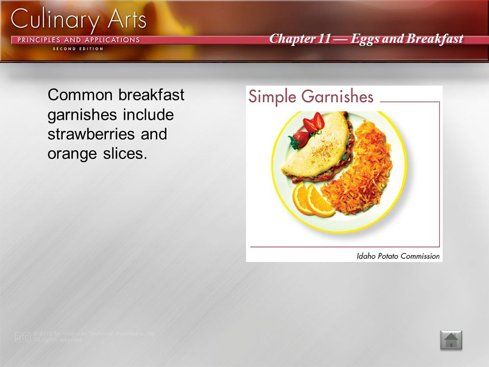 Common breakfast garnishes include strawberries and orange slices.
