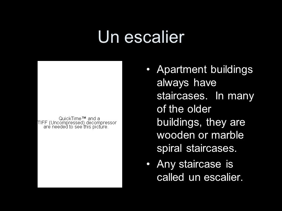 Un escalierApartment buildings always have staircases. In many of the older buildings, they are wooden or marble spiral staircases.