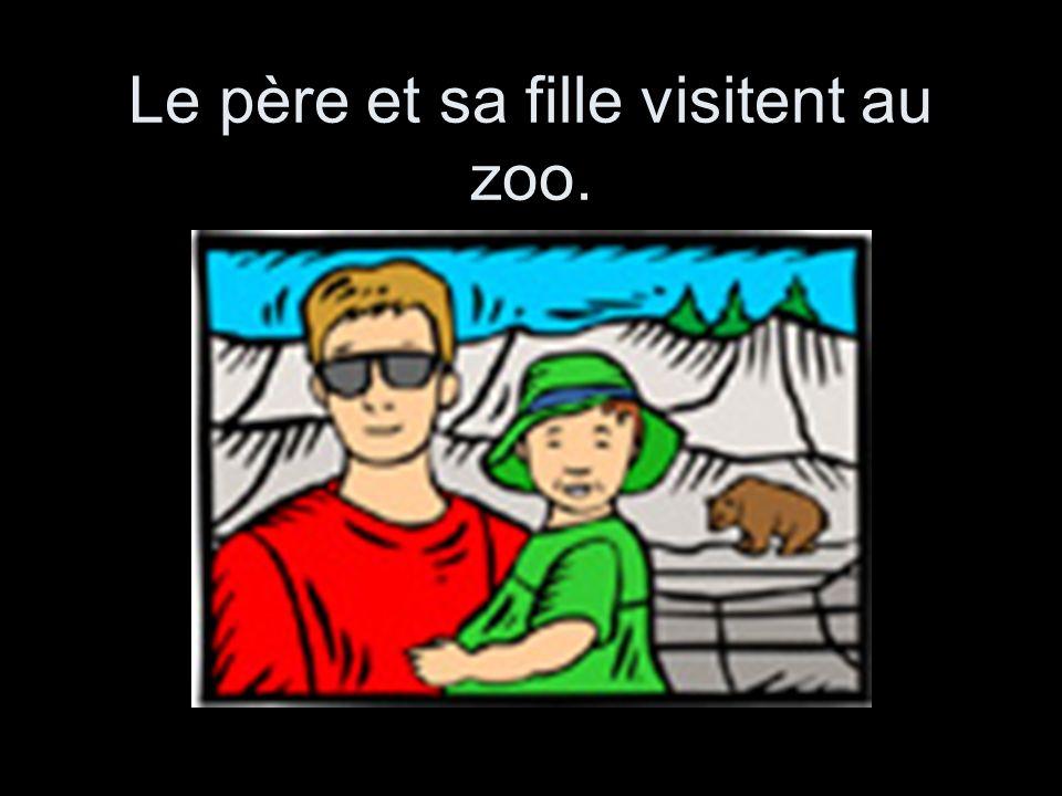 Le père et sa fille visitent au zoo.