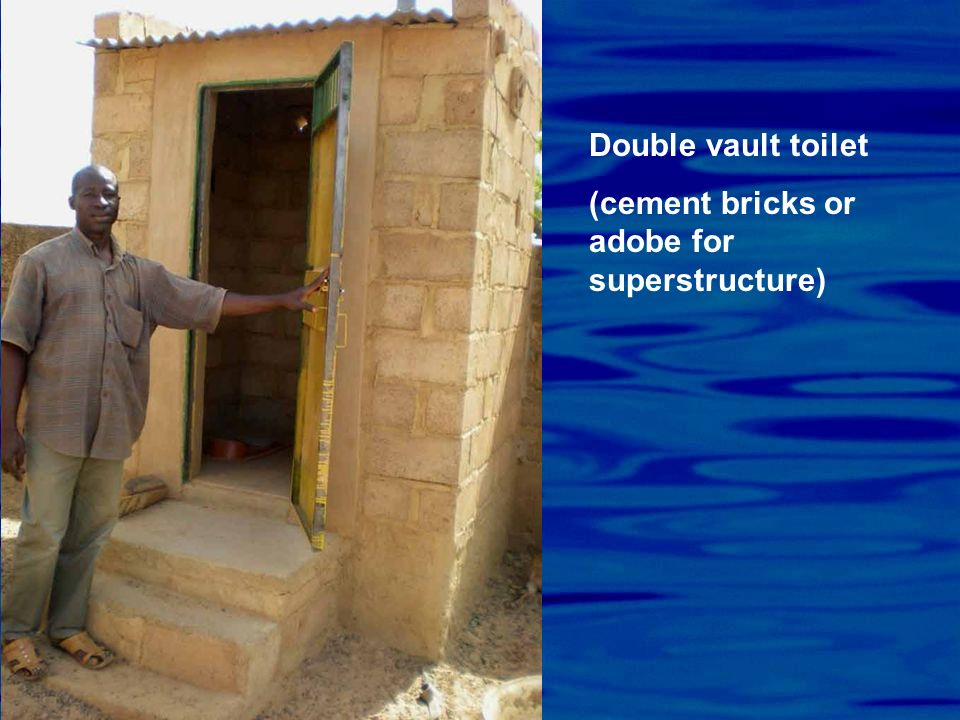 Double vault toilet (cement bricks or adobe for superstructure)