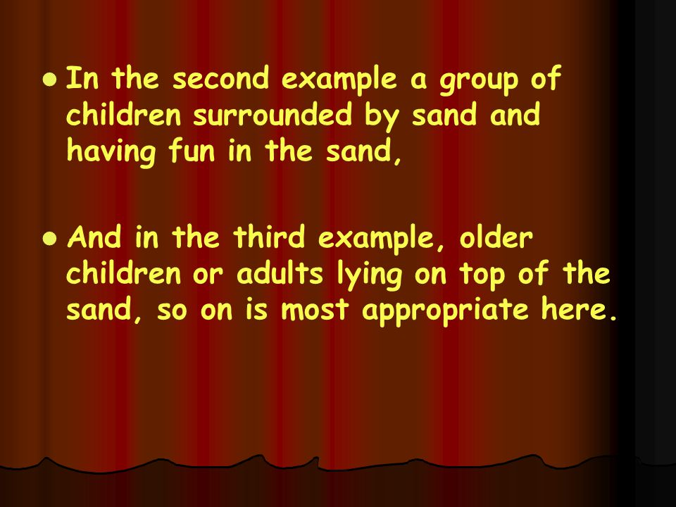 In the second example a group of children surrounded by sand and having fun in the sand,