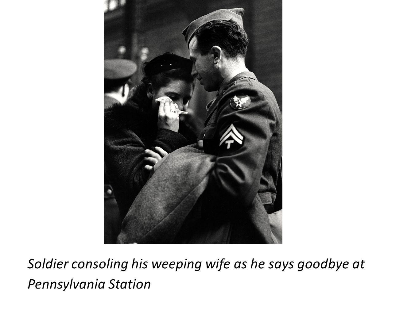 Soldier consoling his weeping wife as he says goodbye at Pennsylvania Station