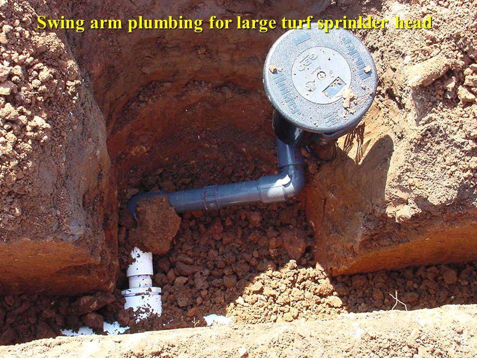 Swing arm plumbing for large turf sprinkler head