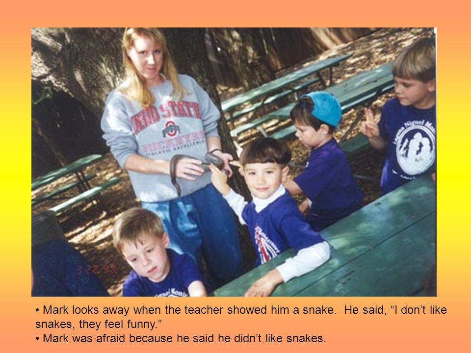 Mark looks away when the teacher showed him a snake