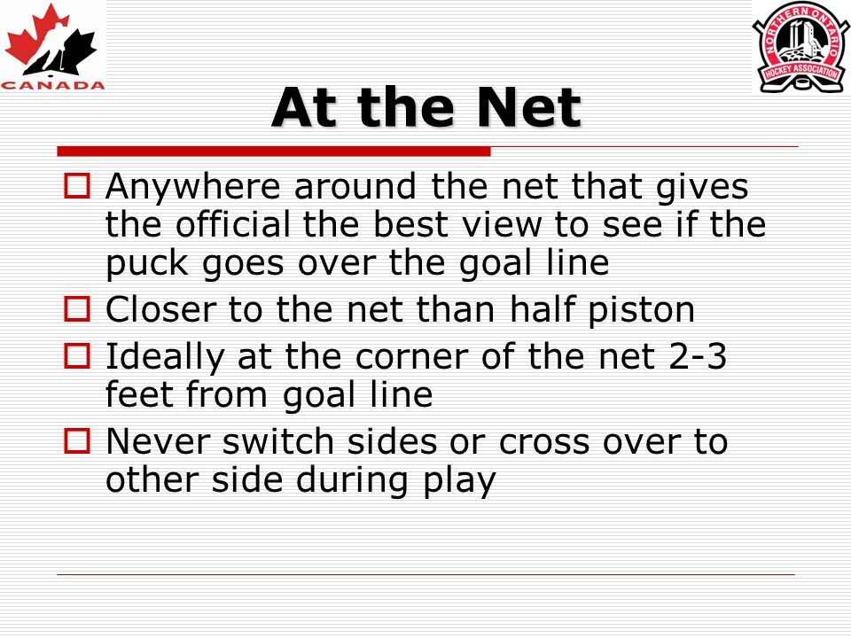 At the Net Anywhere around the net that gives the official the best view to see if the puck goes over the goal line.
