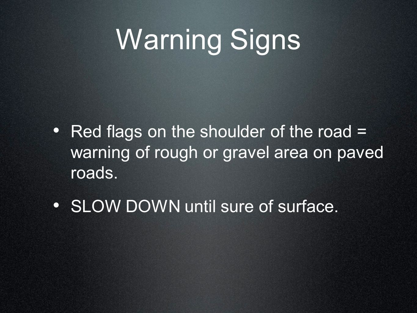 Warning Signs Red flags on the shoulder of the road = warning of rough or gravel area on paved roads.
