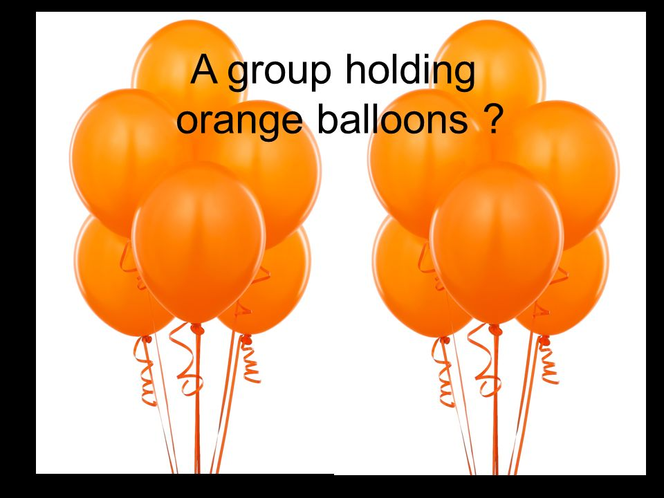 A group holding orange balloons