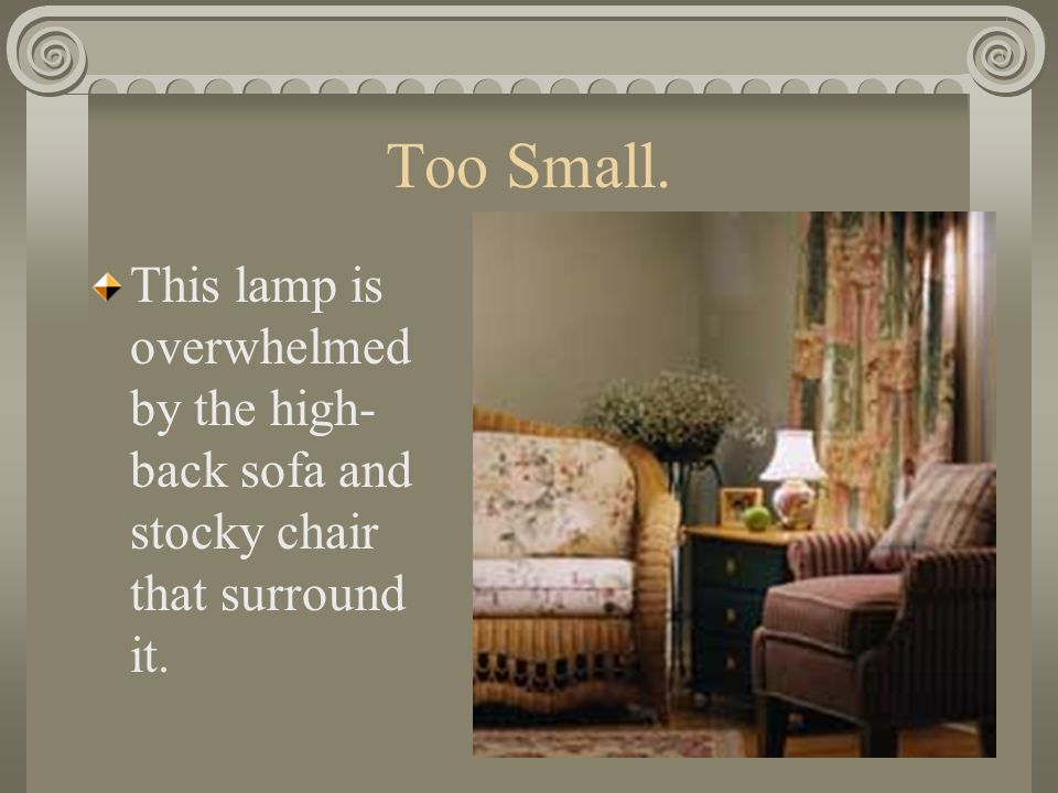 Too Small. This lamp is overwhelmed by the high-back sofa and stocky chair that surround it.