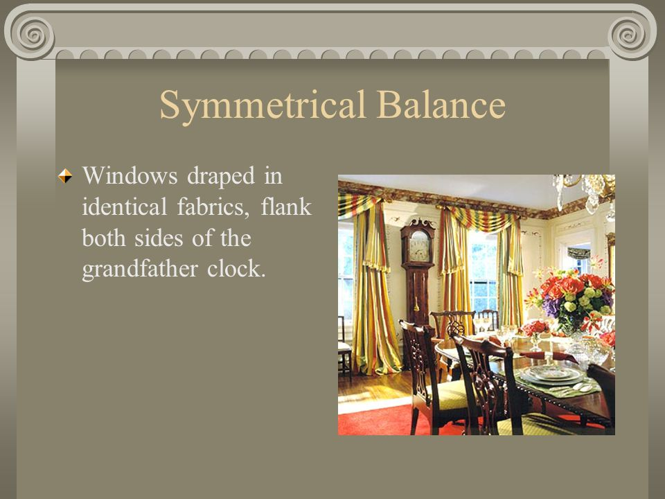 Symmetrical Balance Windows draped in identical fabrics, flank both sides of the grandfather clock.