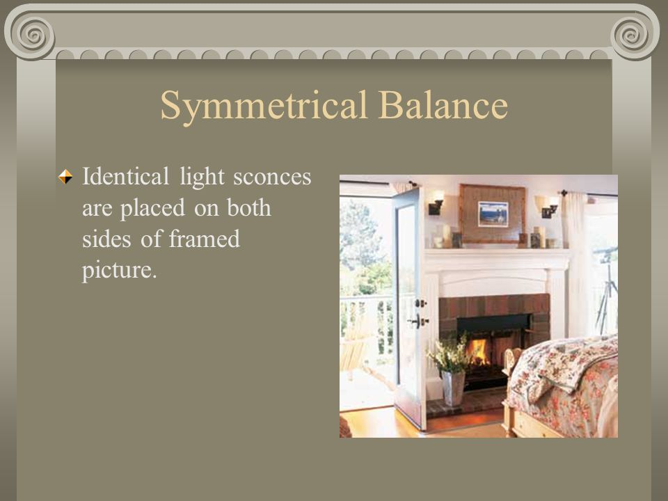 Symmetrical Balance Identical light sconces are placed on both sides of framed picture.
